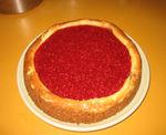 Chocolate swirl cheesecake with raspberry glaze and waffle cone crust (yum!)
