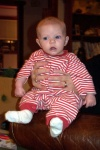 Annabel sitting up with the help of Grandma Joan