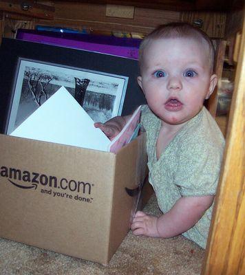 Annabel getting into a box
