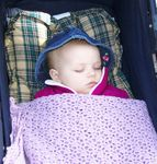 Annabel sleeping snuggly in the stroller