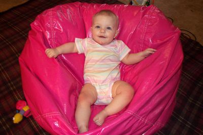 Annabel kickin' it in her hot pink beanbag (that needs to be re-covered)