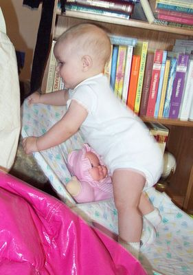 Annabel crawling over the bouncy chair