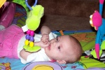 Annabel playing with Mr. Frog on the playmat