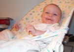 Annabel smiling at Mommy in the bouncy chair