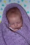 Annabel sleeping in the bouncy chair