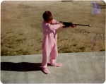 Harold in his pink jammies with his new BB Gun!