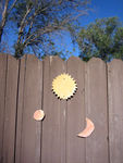 Annabel's contribution to our fence art. Fired & glazed pottery sun, moon & earth :)