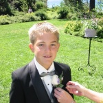 Bradley getting his corsage pinned on