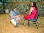 Brent putting the garter on Katie