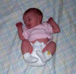 Annabel sleeping on a beautiful quilt made by her great-Aunt Betty in Minnesota