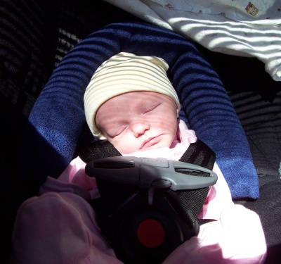 Annabel in her carseat for a trip into town